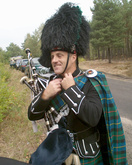 The ceremony could hardly be held without a real Scottish piper